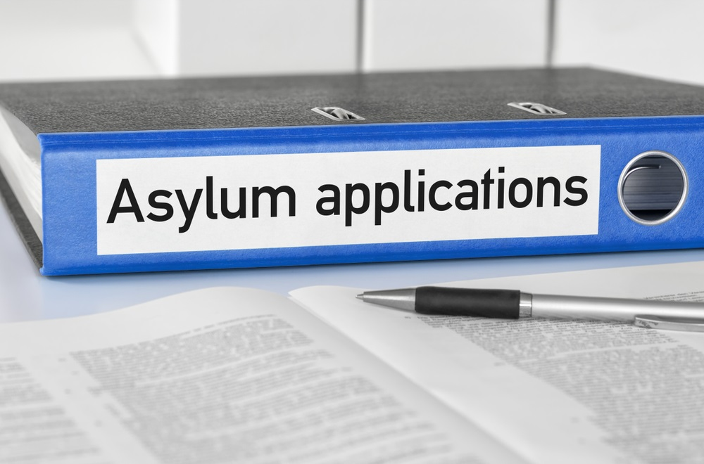 A blue folder with the label Asylum applications